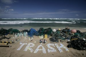 Plastic is displayed on a beach and the word 'Trash' is spelt out from golf balls. The wide variety of items shown in this image highlight the diverse range of sources from which the plastics in our oceans originate. This is part of the Ocean Defenders Campaign in which the Greenpeace ship Esperanza MV sails to the Pacific Ocean, sometimes referred to as the North Pacific garbage patch, to document the threat that plastic poses to the environment and sea life.
